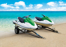 Jet Ski Docked At The Shore On A Tropical Beach