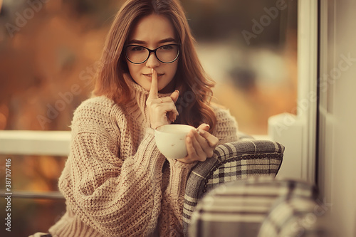happy girl autumn cafe sweater concept vision model with glasses posing - 387107416