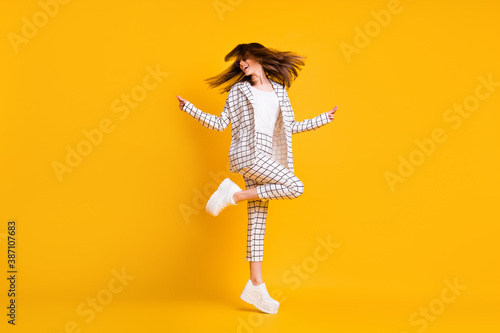 Full length body size side profile photo of girl wearing white checkered suit roung sunglass dancing isolated on vivid color background - 387107683
