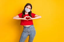Photo Of Positive Girl Make Fingers Heart Show Passionate Love Sign Wear Mask Isolated Over Bright Shine Color Background