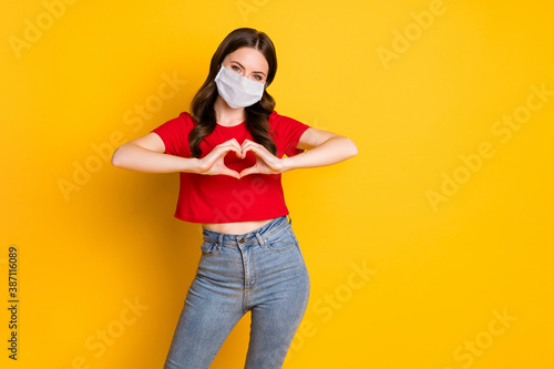 Photo of positive girl make fingers heart show passionate love sign wear mask isolated over bright shine color background - 387116089