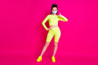 Leinwandbild Motiv Full length photo of young woman dressed sportwear mask hand thumb up arm waist isolated pink color background