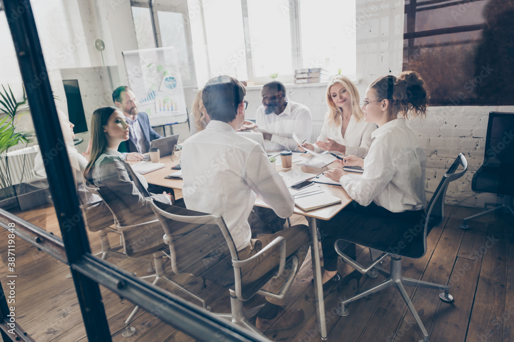 Fototapeta Photo of success business people eight diversity age race colleagues sit table share anti crisis crash ideas team professionals 2020 budget improvement speaking discussion office indoors