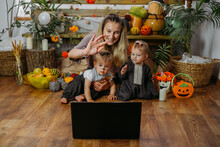 Holidays In The Time Of COVID. Happy Family, Mother And Baby Celebrating Halloween Via Internet In New Normal, Pandemic Time. Online Holiday Party Concept