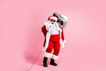 Full Length Photo Cool Crazy Grey White Hair Beard Santa Claus Big Belly Sing X-mas Christmas Eve Noel Song Hold Boom Box Mic Wear Suspenders Cap Sunglass Isolated Pink Color Background