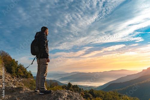 Handsome young man traveler hiking in mountains Fototapeta