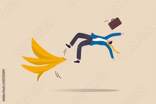Fotografiet Business mistake or accident, insurance, disaster suddenly happened without warning or risk and danger in investment concept, businessman running and slipping with big banana peels on the ground