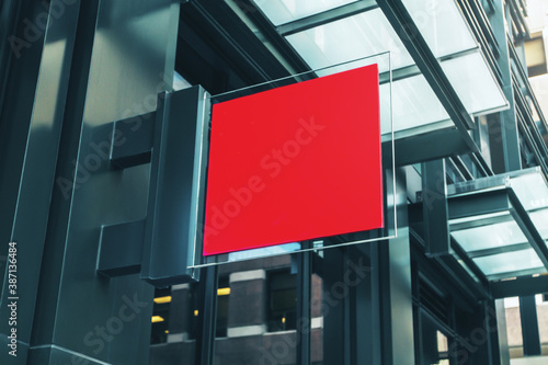 Red square signboard on the wall of a modern shopping mall, mock up - 387136484