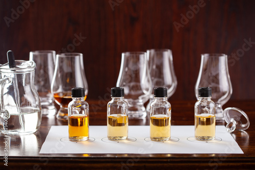 tasting bottles and glasses of whisky spirit brandy cognac Fototapet