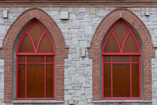 Arched Windows On The Old Wall