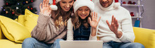 Joyful Family In Santa Hats Waving Hands While Having Video Chat On Christmas, Banner