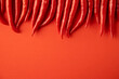 Leinwandbild Motiv spicy red chili pepper on red background