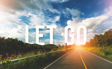 Let Go Written On Highway Road...