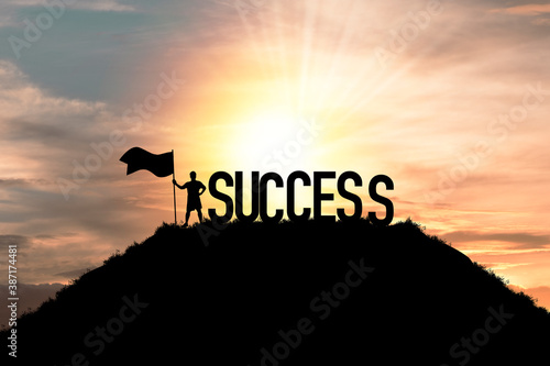 Fototapety, obrazy: Silhouette business man standing and holding flag with success wording on the top of mountain, business success and achievement objective target concept.