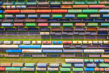 Freight Trains Made Up Of Multi-colored Wagons, Aerial View.