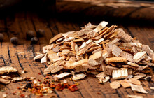 Wood Chips For Smoking Meat Or Fish On An Old Wooden Table Close-up.