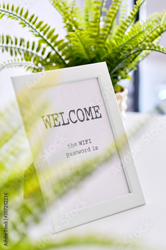 Obraz In white frame Wi fi password is and Welcome text - fototapety do salonu