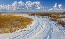Ground Road Among A Snowbound Prairie, Winter Transportation Scene