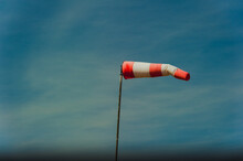 Wind Indicator At The Airfield Against The Blue Sky.