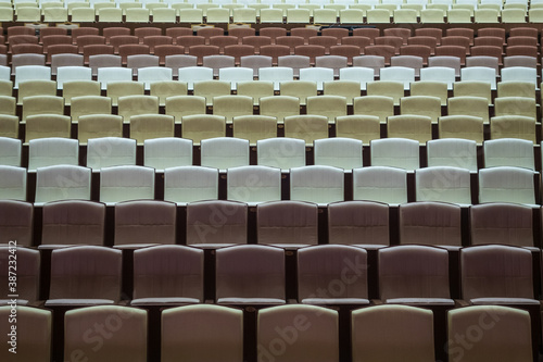Rows of vacant spectators seats in theater. Abstract background. Canvas