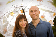 Halloween. Happy Couple At Halloween Picnic. Emotion Concept. Man And Woman Under An Umbrella With Cobwebs.