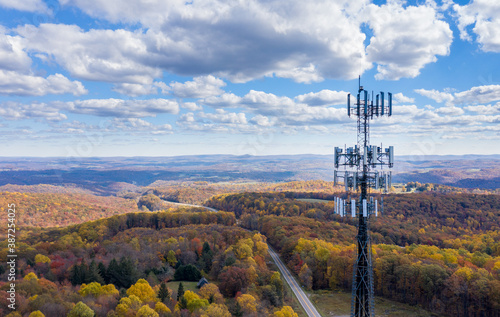 Aerial view of mobiel phone cell tower over forested rural area of West Virginia to illustrate lack of broadband internet service © steheap