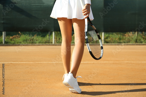 Obraz Sportswoman playing tennis at court on sunny day, closeup - fototapety do salonu