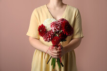 Woman With Bouquet Of Beautiful Dahlia Flowers On Brown Background, Closeup