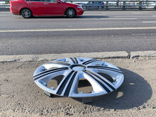 Lost Hubcap On The Side Of A C...