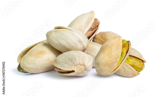 Fotografia Pistachio nuts. Isolated on a white background