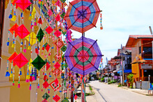Colorful Spider Web Flag Of Thai Local Traditional Buddhist Belief Merit Old Style For Protect Is Widespread Decorate Flags In Religion Events In The Northeast Of Thailand.