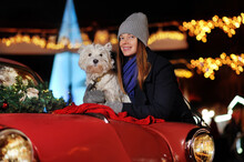 Woman With Her Dog At The Chrismas Decoration With Retro Car