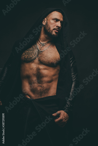 Muscular guy with sexy torso on black Fototapeta