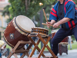 Man Playing Drums of Japanese Musical Tradition during a Public Outdoor Event