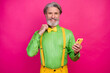 Leinwandbild Motiv Photo of funny white haired grandpa hold telephone look mirror fix elegant bow tie metrosexual wear green shirt yellow suspenders pants isolated shine bright pink color background