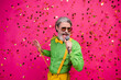 Leinwandbild Motiv Photo of funny aged grandpa club party singing karaoke microphone confetti fall excited singer wear sun specs green shirt yellow suspenders tie isolated shine pink color background