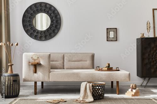 Fotografija Modern ethnic living room interior with design chaise lounge, round mirror, furniture, carpet, decoration, stool and elegant personal accessories