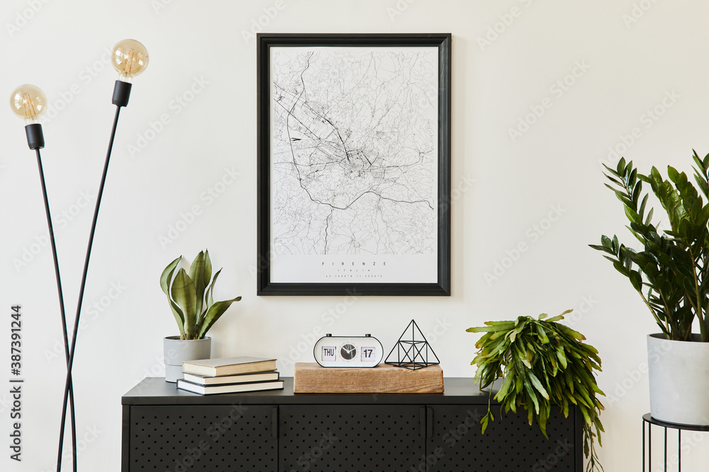 Fototapeta Stylish composition of living room interior with design black commode, a lot of plants, mock up poster map, decoration and elegant personal accessories. template. Modern home decor.