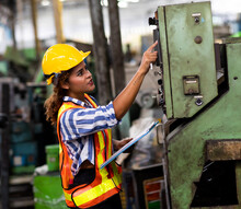 African American Engineer Woman Wearing Safety Goggles Control Lathe Machine To Drill Components. Metal Lathe Industrial Manufacturing Factory. Engineer Operating  Lathe Machinery