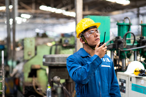 Fotografie, Obraz Portrait of factory worker and engineer at industrial facility