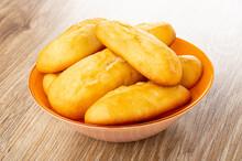 Biscuit Cookies In Orange Bowl On Wooden Table