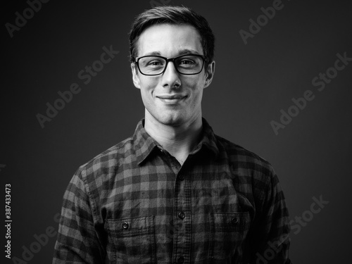 Obraz Young handsome hipster man in black and white - fototapety do salonu