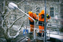 Two Electricians In Orange Ove...