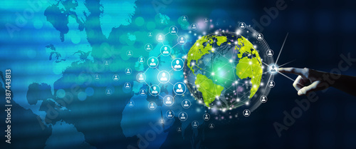 New global business connection concept. Businessman leading the global connection with connecting people orbit around the world. World map and connecting people background. Original source from NASA.