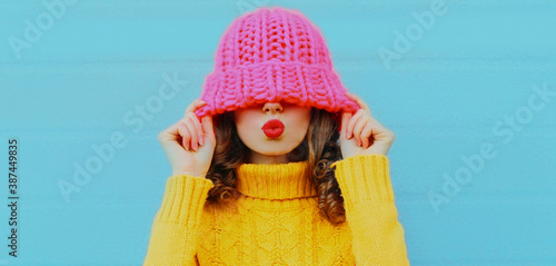 Winter portrait of young woman blowing red lips sending sweet air kiss female mo Canvas-taulu