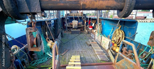 Deck of a sea trawler. Nets, winches and other equipment on view. Canvas