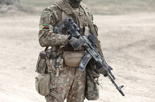 Soldier With Assault Rifle And...