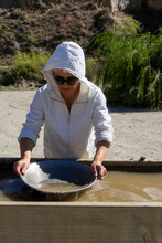 Women Panning For Gold At At Goldfields Mining Centre, New Zealand