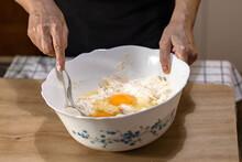 Eggs On Raw Dough In A Bowl Mi...