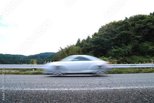Fototapeta speeding car on the highway